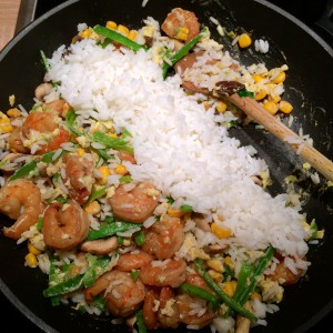 Stir fry and rice in a pan