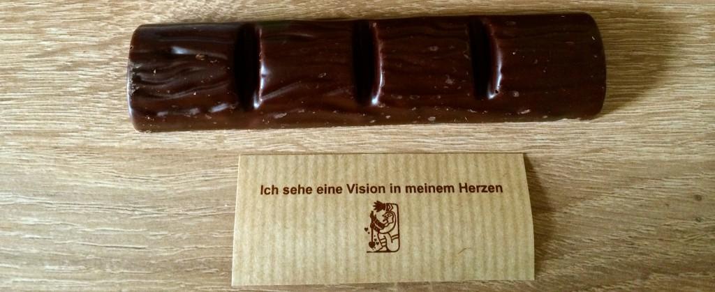 """Ausgepackter Riegel mit Spruchzettel """"Ich sehe eine Vision in meinem Herzen"""""""