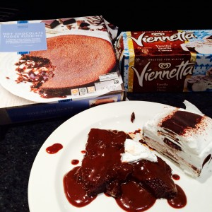 A quarter Hot Chocolate Fudge Pudding  and Viennetta ice-cream with packaging in the back