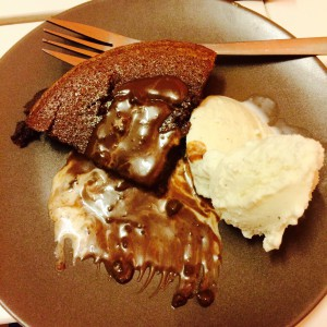 A quater Hot Chocolate Fudge Pudding  with a scoop of vanilla ice-cream