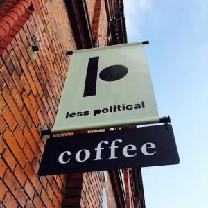 Less Political Hamburg Logo als Schild an der Außenwand